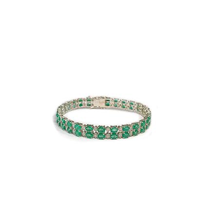 Bracciale tennis con doppia fila di smeraldi e diamanti